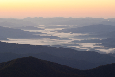 newfound gap: Sunrise and fog over The Great Smoky Mountains. Stock Photo