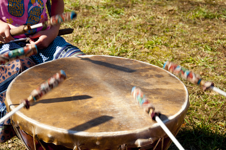 wail: Indian drums being played by a young child. Stock Photo
