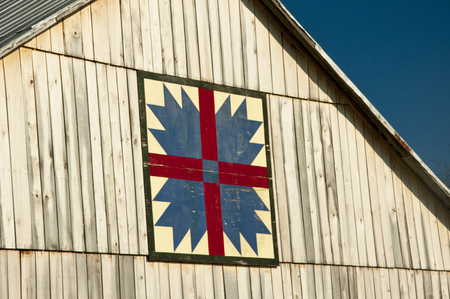 outbuilding: Country ban with quilt pattern. Stock Photo