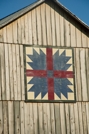 outbuilding: Close-up country barn with quilt pattern.