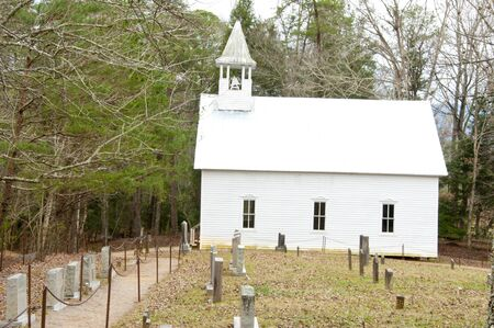 smokies: Little White Church in Cades Cove with graves. Stock Photo