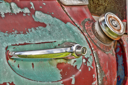 Door handle and gas tank of an old vintage truck.