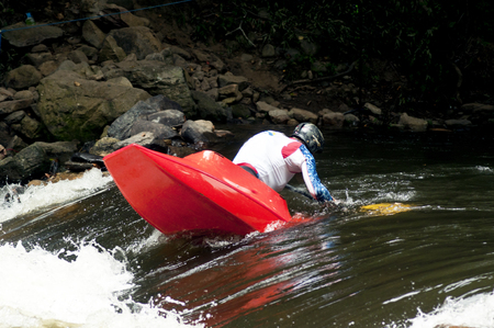lifejacket: Competiting in kayak white water competitions.