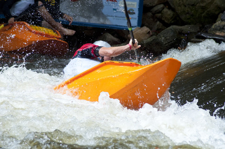 Kayak competiton in white water rapids. Stock Photo