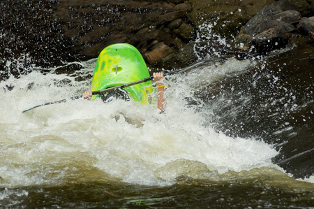 lifejacket: White water kayak competition in rapids.