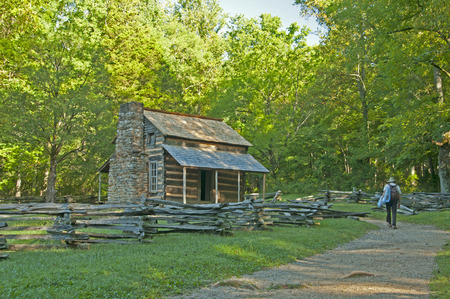 great smokies: A ranger walks to John Oliver house in Cades Cove.