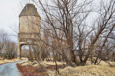 deserted: An old deserted coal chute along a gravel road. Stock Photo