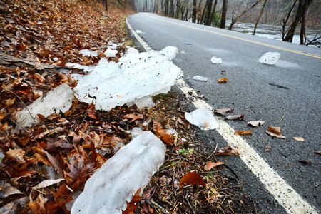 Fallen iciles beside a paved road danger. photo