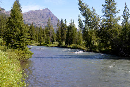 snow capped mountain: Clear blue river leading to a snow capped mountain.