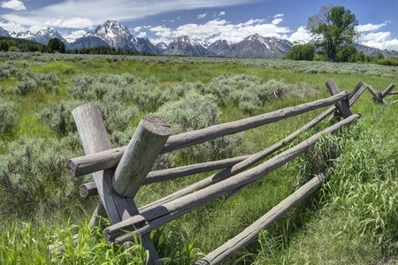 split rail: Beautiful scenic with split rail fence and snowy mountains. Stock Photo