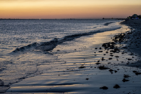 wading: Sunset colors along the beach
