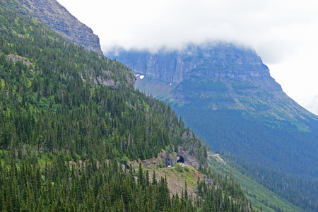 Fog hovers over the mountains of Glacier National Park. Stock fotó