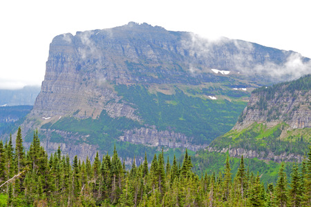 Fog on Glacier National Park in summer. Imagens