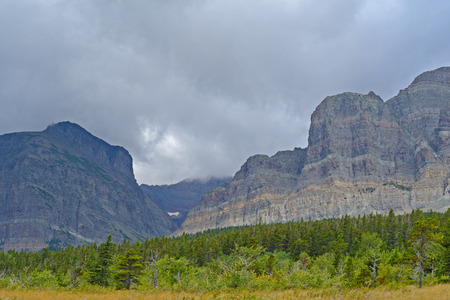 Clouds cover the mountains and valleys of Glacier National Park.
