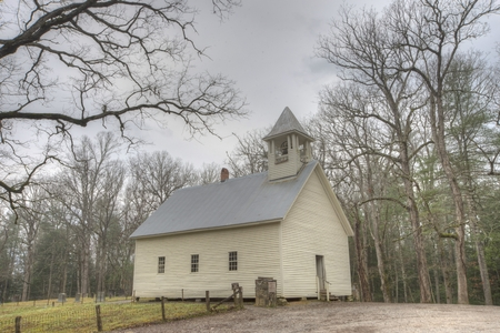 A little white church sits in the mountains of Cades Cove.