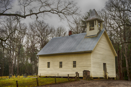 A little white church is nestled inside the mountains of Cades Cove.