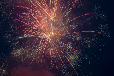 Sparkling fireworks light up the night sky. Stock Photo - 105096478