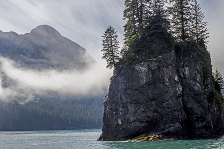 Fog hangs around Resurrection Bay in Seward, Alaska. Reklamní fotografie