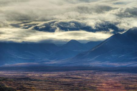 Mt. Denali stands above the landscape of Denali National Park.