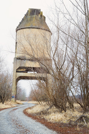 Road going under a vintage coal chute. Editorial