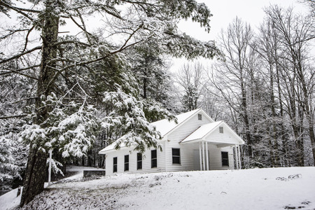A little white country church on a snowy day.