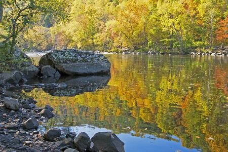Water reflections of fall colors along the Pigeon River.