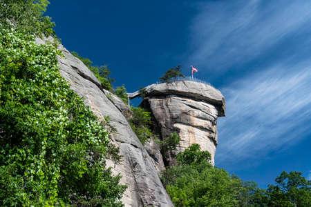 Chimney Rock State Park under clear blue skies.