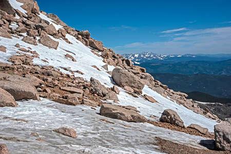 Mt. Evans, Colorado, after a snow melt hosts wild Big Horned Sheep.