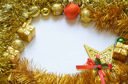 Christmas frame. Christmas balls, garland, red and golden decorations on white background. Flat lay, top view, copy space.