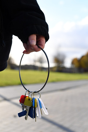 a person holding keys in her hand