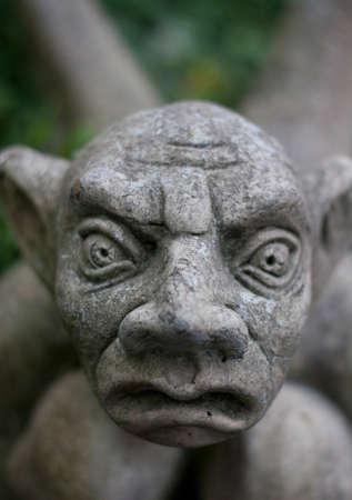 gremlin: Stone garden statue of a gargoyle