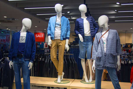 Mannequins in a clothing store in autumn style