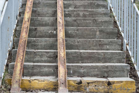 Exterior staircase with a wheelchair ramp on. Old staircase in the city