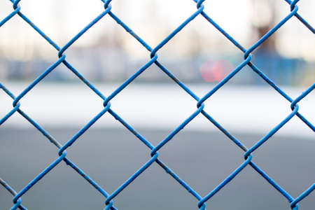 Fence on the sky, blue mesh fence, chain link fence Soft focus.