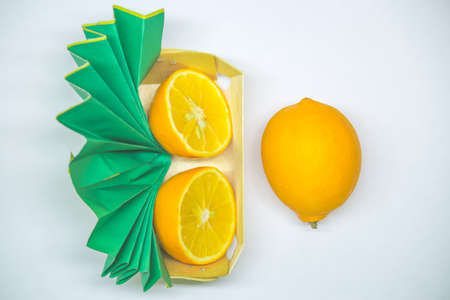 lemons in a box top view. White background. copy space