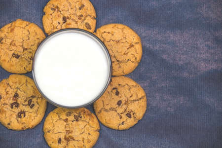 Cookies with milk on a blue background copy space Stock fotó