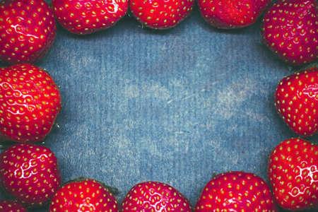 strawberries on a dark blue background copy space Stock fotó