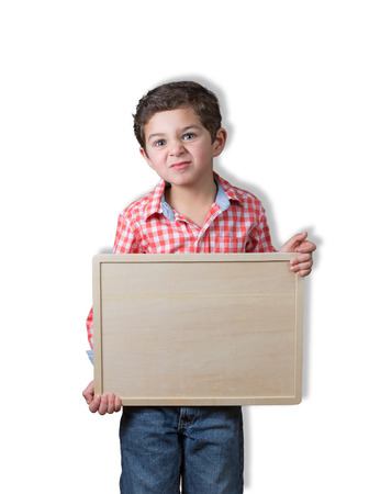 Handsome pre-schooler with peculiar look provides some copy space