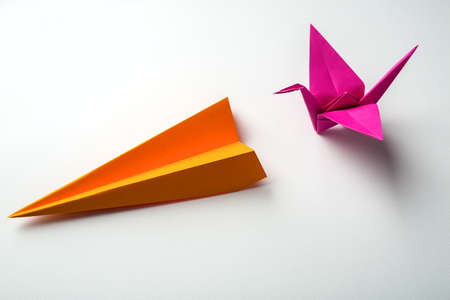 row of colored paper origami plane and crane photo
