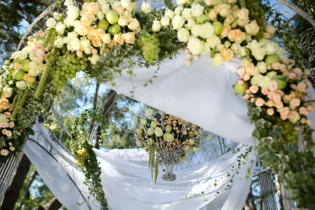 trees services: Flower wedding arch beautifully decorated in the forest resort