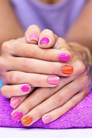 Bright stylish manicure with colored nail polish