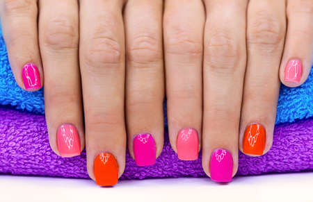 finger nail: Bright color manicure on a bright background