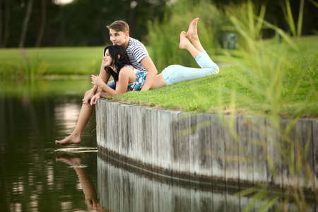 couple in love: Young couple in love near the water Stock Photo