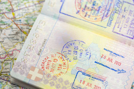 credential: passports with maldives and thailand visa stamps