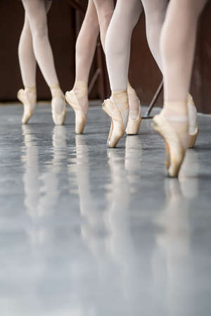 shoes fashion: Legs dancers on pointe, near the choreographic training machine. Stock Photo