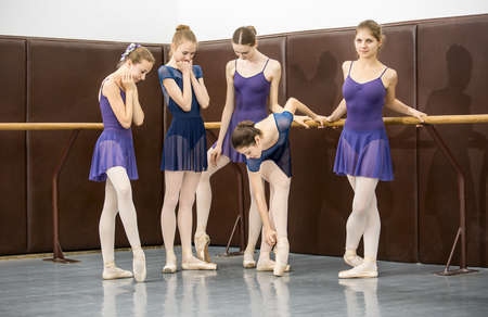 group of teenagers involved in choreographing the dance hall near the barre 스톡 콘텐츠