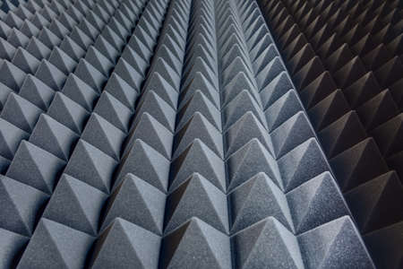 Texture soundproof panels in perspective. Triangles of the same shape of a special sound-absorbing polymer material gray. High-tech background. photo