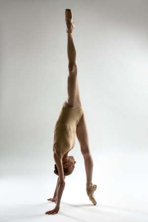 Ballerina makes perfectly smooth twine standing on one pointe, with his other leg up.