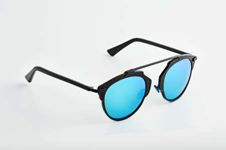 tinted: Stylish glasses with blue tinted mirror isolated on white background