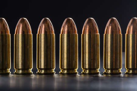 9mm ammo: Number pistol cartridge 9 mm caliber on a black background